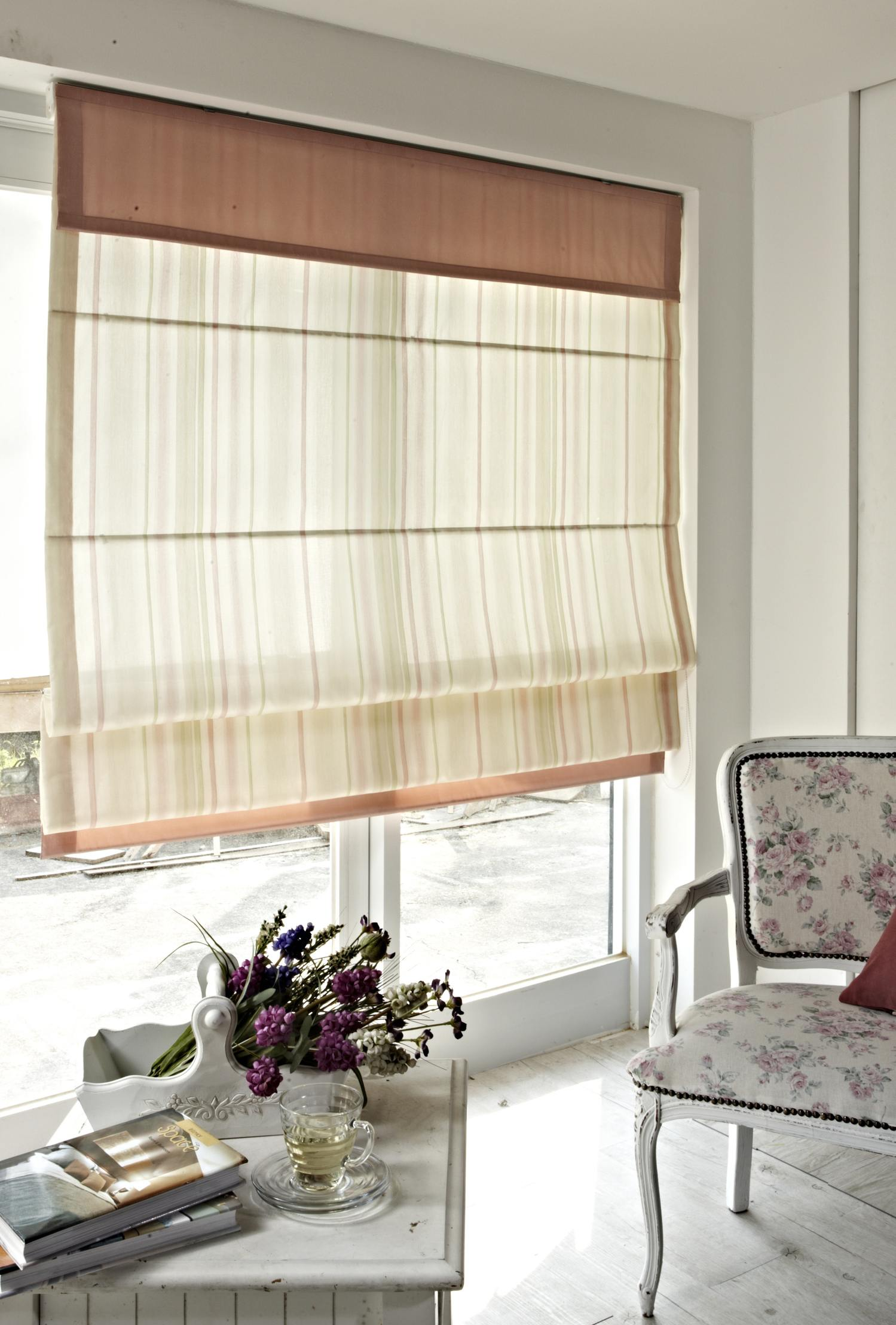 An image of a Roman blind in situ at a window.