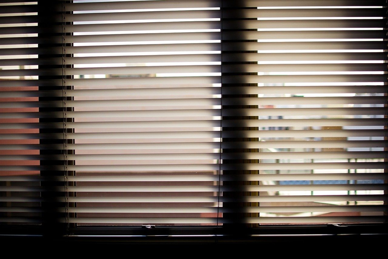 image of blinds drawn in a home for privacy
